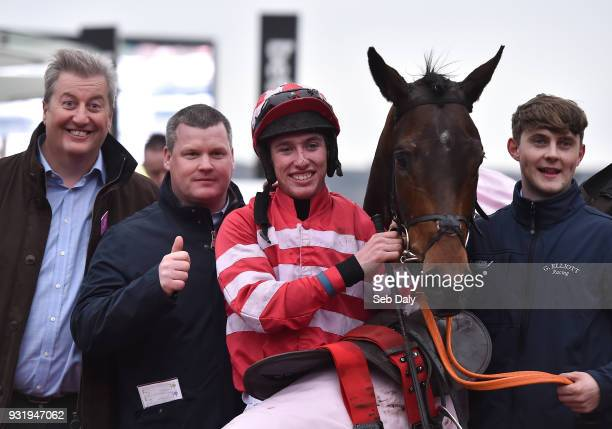 Cheltenham United Kingdom 14 March 2018 Jockey Jack Kennedy with trainer Gordon Elliott second left after winning the Boodles Fred Winter Juvenile...