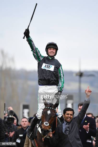 Cheltenham United Kingdom 14 March 2018 Jockey Nico de Boinville celebrates as he enters the winners' enclosure after winning the Betway Queen Mother...