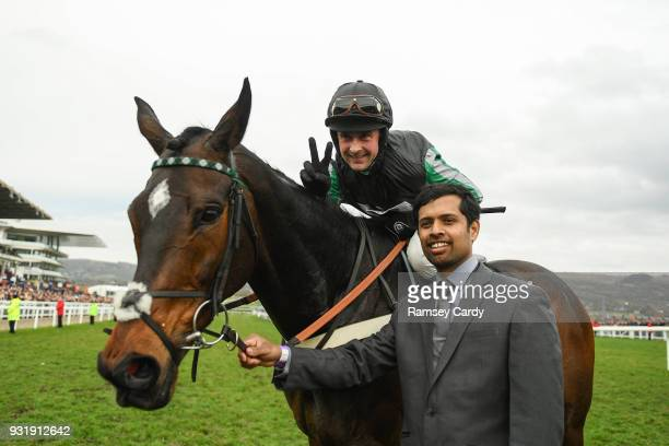 Cheltenham United Kingdom 14 March 2018 Jockey Nico de Boinville celebrates winning The Betway Queen Mother Champion Steeple Chase on Altior on Day...