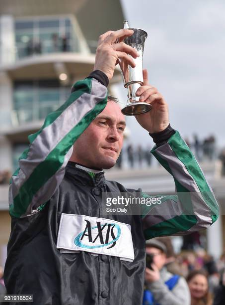 Cheltenham United Kingdom 14 March 2018 Jockey Nico de Boinville celebrates with the trophy after winning the Betway Queen Mother Champion Steeple...