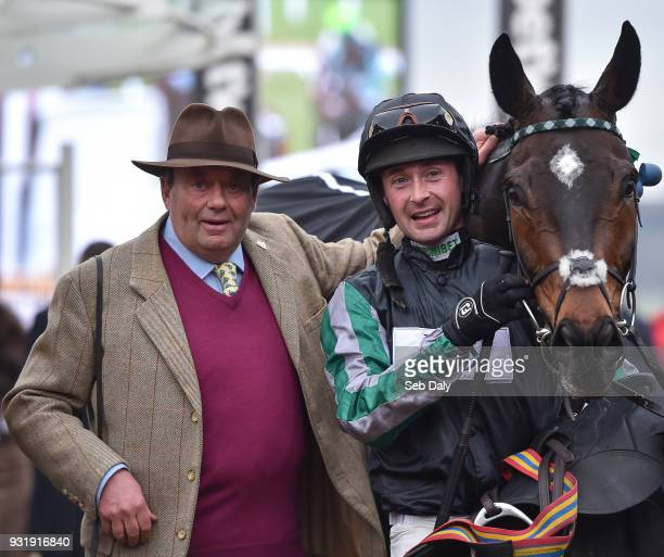 Cheltenham United Kingdom 14 March 2018 Trainer Nicky Henderson left with jockey Nico de Boinville after winning the Betway Queen Mother Champion...