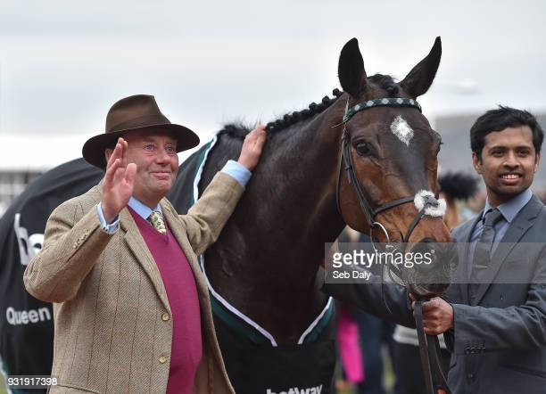 Cheltenham United Kingdom 14 March 2018 Trainer Nicky Henderson acknowledges the crowd after sending out Altior to win the Betway Queen Mother...