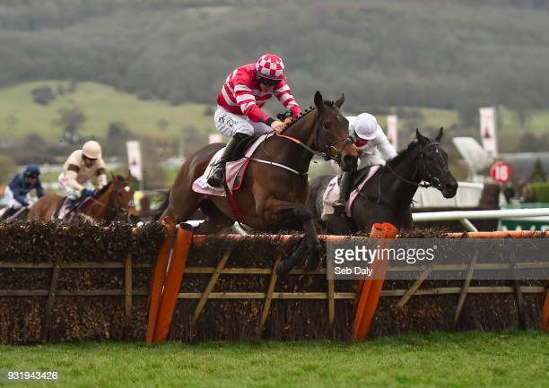Cheltenham United Kingdom 14 March 2018 Veneer Of Charm with Jack Kennedy up jump the last on their way to winning The Boodles Fred Winter Juvenile...