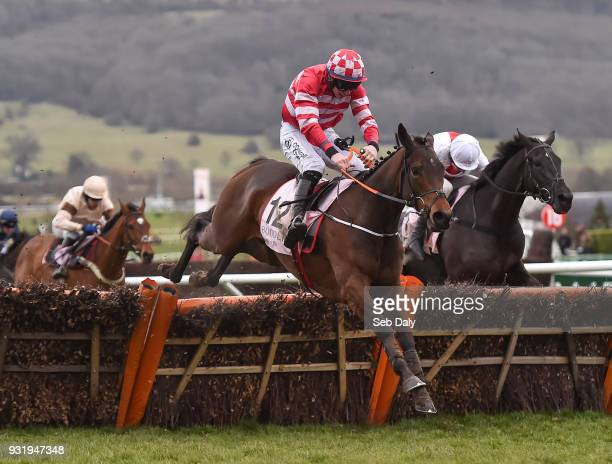 Cheltenham United Kingdom 14 March 2018 Veneer Of Charm with Jack Kennedy up jumps the last on their way to winning the Boodles Fred Winter Juvenile...