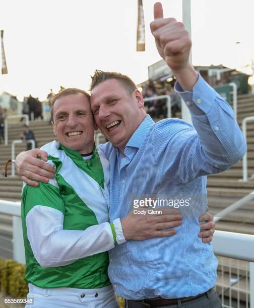 Cheltenham United Kingdom 15 March 2017 Jockey Jamie Codd celebrates with friend Ian O'Connell from East Cork after winning the Weatherbys Champion...