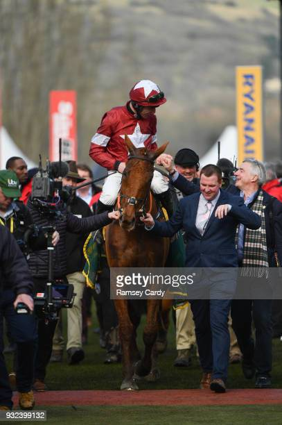Cheltenham United Kingdom 15 March 2018 Jockey Davy Russell shakes hands with the winning owner Michael O'Leary after winning the Ryanair Steeple...