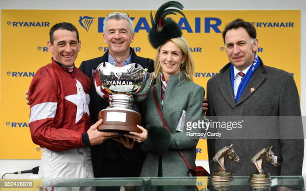 Cheltenham United Kingdom 15 March 2018 Jockey Davy Russell celebrates with from left owner Michael O'Leary Anita O'Leary and trainer Henry De...