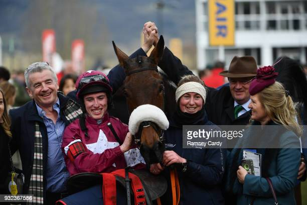 Cheltenham United Kingdom 15 March 2018 Jockey Jack Kennedy with Michael O'Leary left along with stablehand Camilla Sharples and Eddie O'Leary and...