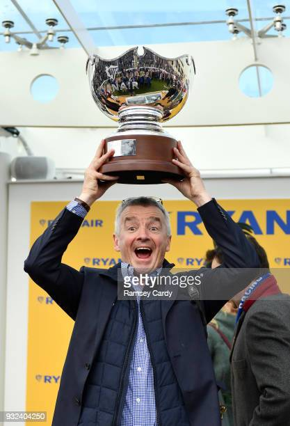 Cheltenham United Kingdom 15 March 2018 Owner Michael O'Leary lifts the cup after winning the Ryanair Steeple Chase with Balko Des Flos on Day Three...
