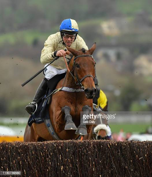 Cheltenham United Kingdom 15 March 2019 Hazel Hill with Alex Edwards up jumps the last on their way to winning the St James's Place Foxhunter...