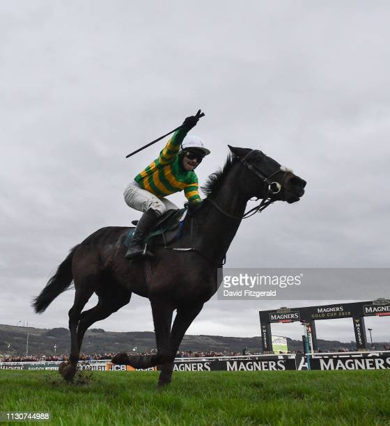 Cheltenham United Kingdom 15 March 2019 Jonjo O'Neill Jr celebrates on Early Doors as they cross the line to win the Johnny Henderson Grand Annual...