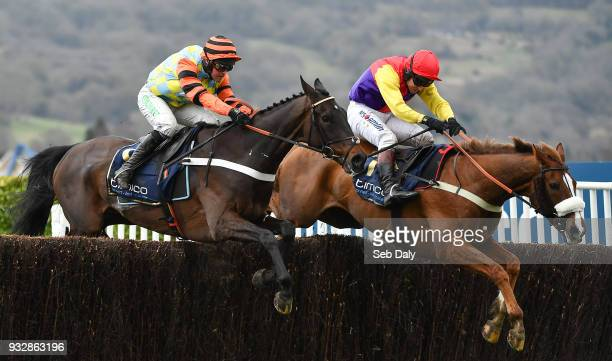 Cheltenham United Kingdom 16 March 2018 Native River with Richard Johnson up right jump the last fence ahead of eventual second place finisher Might...