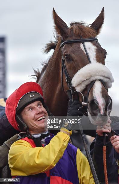 Cheltenham United Kingdom 16 March 2018 Richard Johnson celebrates as he enters the winners' enclosure after winning the Timico Cheltenham Gold Cup...