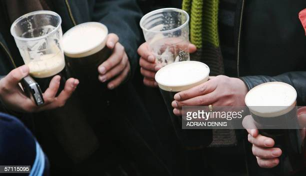 Racegoers at Cheltenham drink pints of Guinness as they celebrate St Patrick's Day before the start of the Gold Cup race 17 March 2006 Meanwhile...