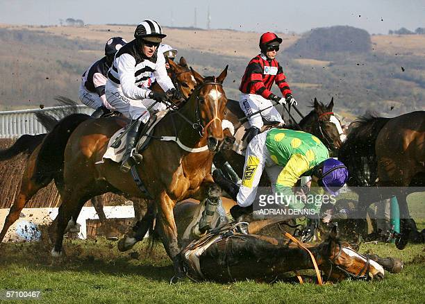 Ruby Walsh falls from French horse Kauto Star while Moscow Flyer ridden by Barry Geraghty tries to avoid him during The Queen Mother Champion Steeple...