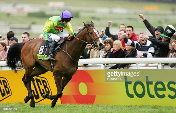 The jockey Ruby Walsh crosses the finish line with horse Kauto Star to win the Cheltenham Gold Cup steeplechase race in the annual Cheltenham Race...