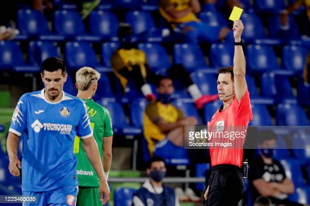 Chema of Getafe receives a yellow card from referee Adrian Cordero during the La Liga Santander match between Getafe v Real Sociedad at the Coliseum...
