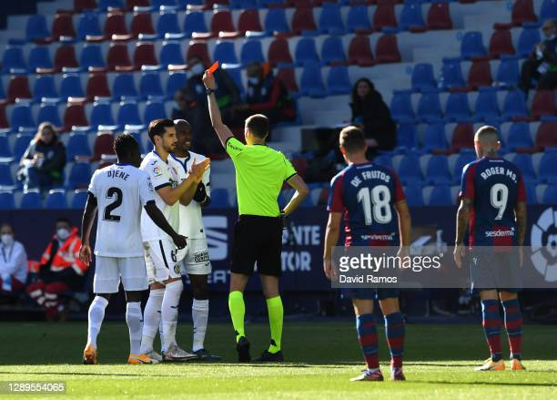 Chema Rodriguez of Getafe is shown a red card and sent off by referee David Medie Jimenez during the La Liga Santander match between Levante UD and...