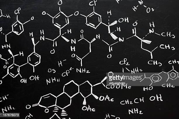 chemical formula written stylishly on a black background - chemistry stock pictures, royalty-free photos & images