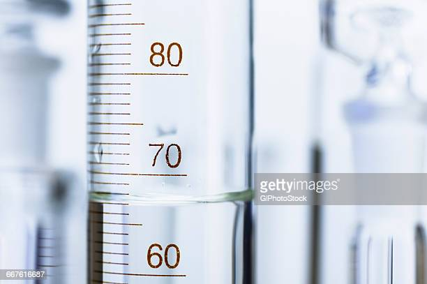 Chemical glassware. Graduated cylinder and other out-of-focus chemical lab glassware