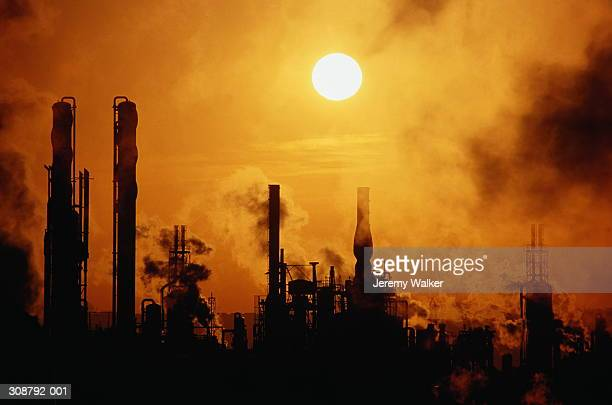 chemical plant silhouetted at sunset - avonmouth stock pictures, royalty-free photos & images