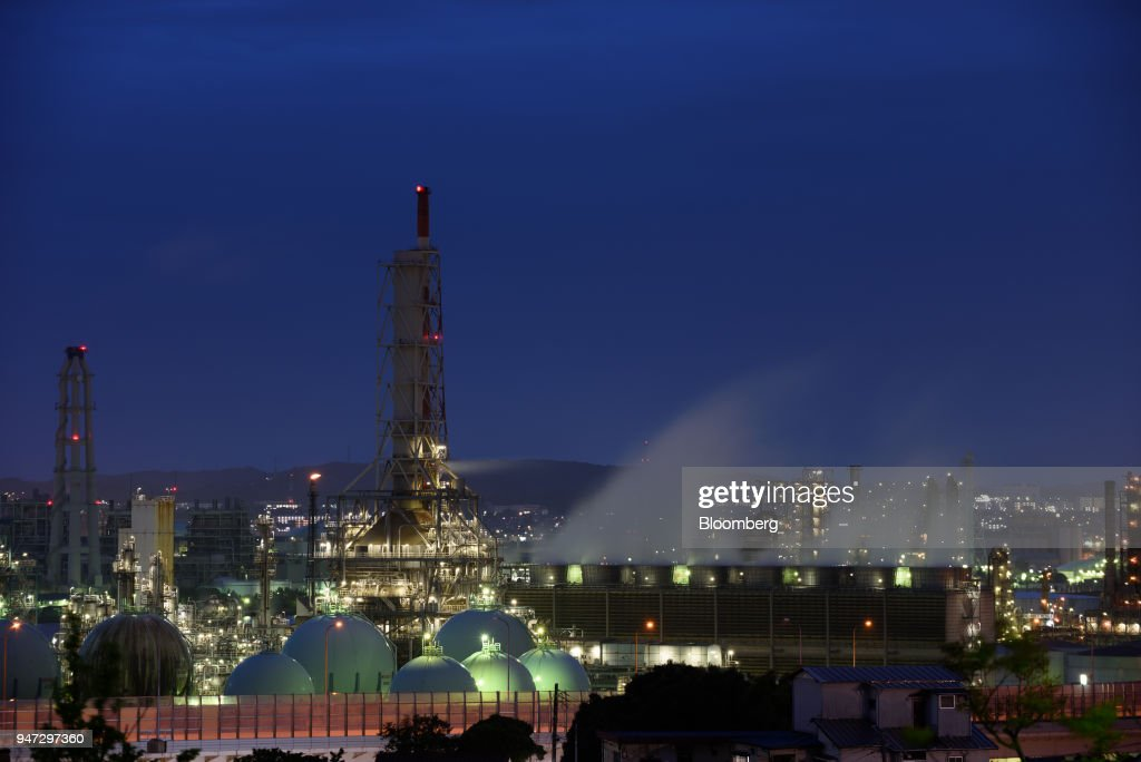A chemical plant stands at dusk in Yokohama, Japan, on Monday, April 16, 2018. Japan and China held their first high-level economic dialogue in almost eight years on April 16 against a backdrop of trade threats from the U.S. Photographer: Akio Kon/Bloomberg via Getty Images