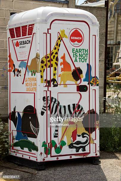 chemical portable toilet decorated with painted animals - portable toilet stock photos and pictures