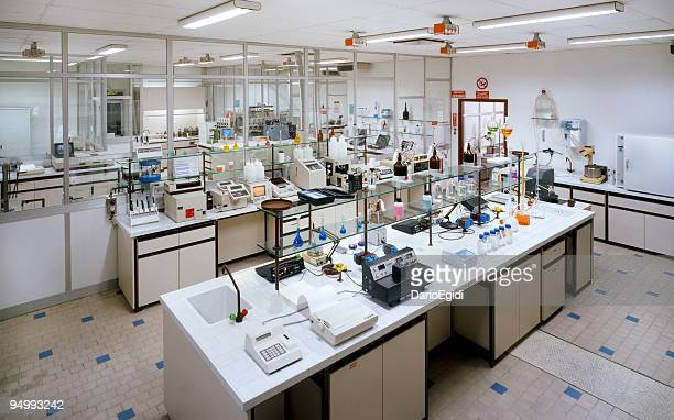 Chemical research laboratory with many instruments on the tables