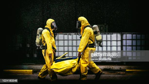 chemical spill pollution response team in action recovery stop spill of the chemical spill pollution at factory . hazard emergency response concept - toxic waste stock pictures, royalty-free photos & images