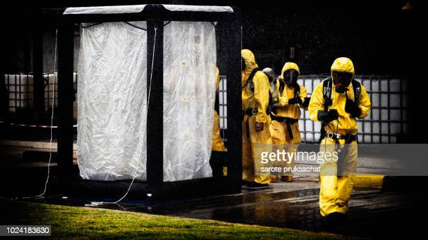 chemical spill pollution response team in action recovery stop spill of the chemical spill pollution at factory . hazard emergency response concept - flammable stock photos and pictures