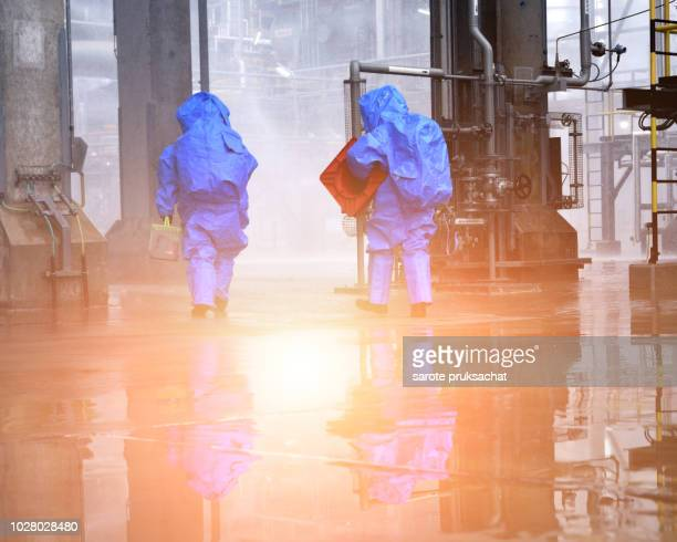 chemical spill pollution response team in action recovery stop spill of the chemical spill pollution at factory . hazard emergency response concept . - brigade stock pictures, royalty-free photos & images