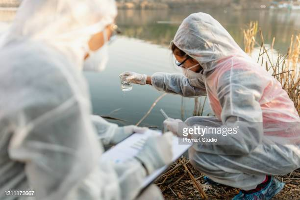 chemical test of water - ecologist stock pictures, royalty-free photos & images