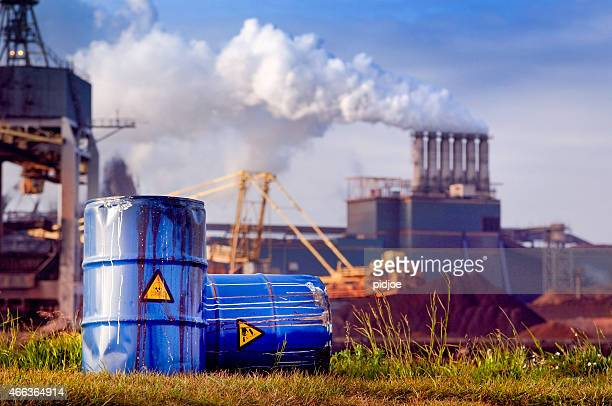 chemical waste drums in front of heavy industry - toxic waste stock pictures, royalty-free photos & images