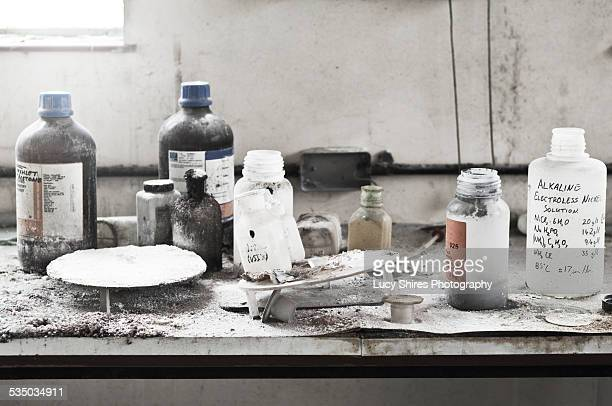 chemicals in abandoned chemical laboratory. - lucy shires stock pictures, royalty-free photos & images