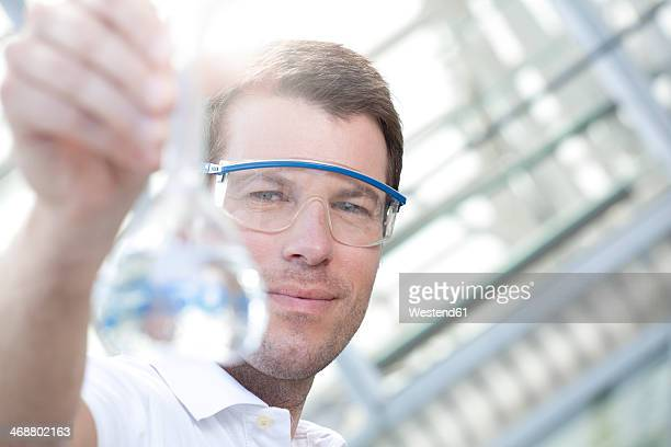 Chemist holding flask