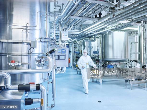 chemist in a chemical factory - chemical stock pictures, royalty-free photos & images