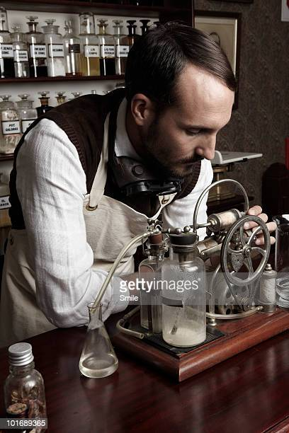 Chemist mixing chemicals in antiquated lab