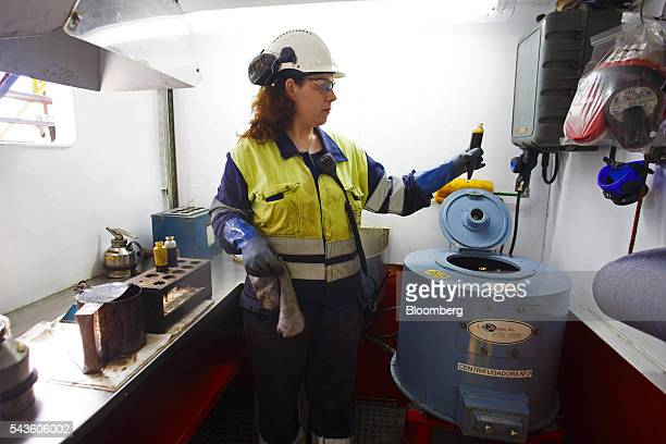 A chemist tests an oil sample on the Casablanca oil platform operated by Repsol SA in the Mediterranean Sea off the coast of Tarragona Spain on...