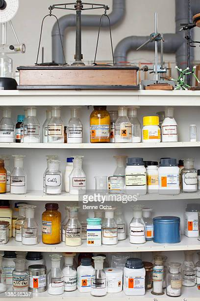 Chemistry classroom, shelves of assorted chemicals and equipment