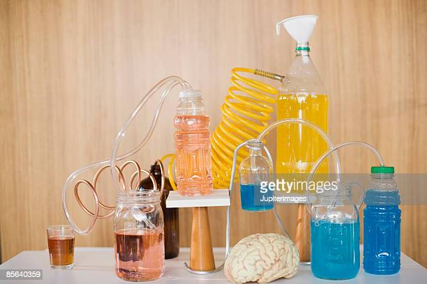 Chemistry still life with bottles and brain