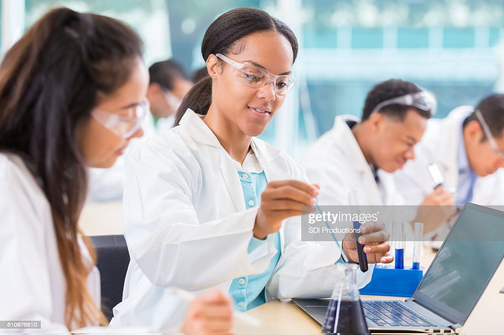 Chemists work on project in lab : Foto de stock