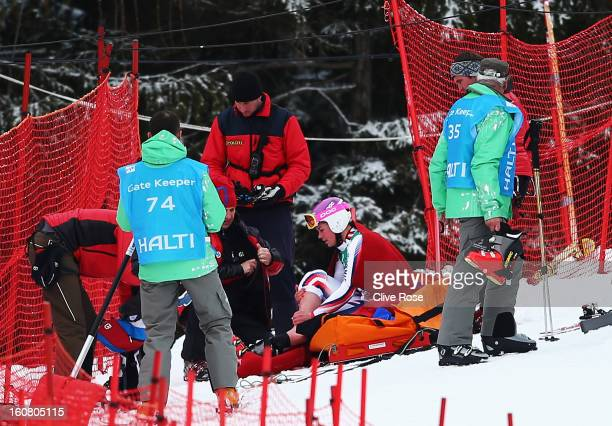 Chemmy Alcott of Great Britain is attended to by medics and marshalls after falling and injuring herself in the Women's Downhill Training during the...