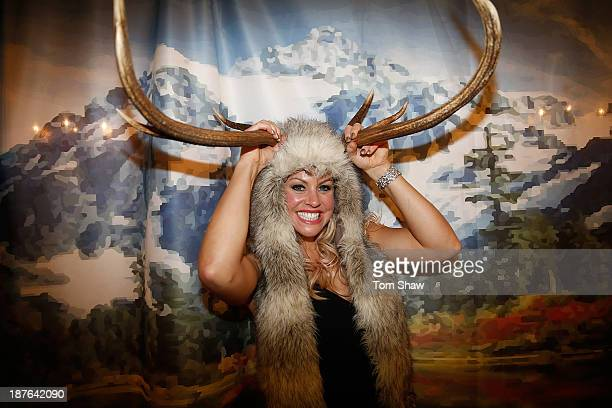 Chemmy Allcott poses in fron to fo the photobooth during the British Olympic Ball at The Dorchester on October 30 2013 in London England