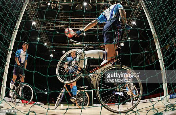 Athletes of Japan and Hongkong compete in the men's cycle-ball event of the UCI Indoor Cycling World Championships 24 November 2006 in Chemnitz,...