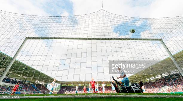 Chemnitz's goalkeeper Kevin Kunz fails to save the first goal by Munich's Polish Forward Robert Lewandowski during the German football Cup DFB Pokal...