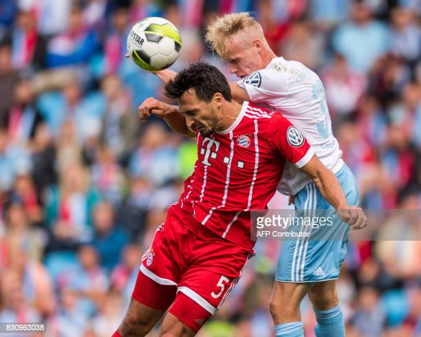 Chemnitz's Tom Scheffel and Munich's defender Mats Hummels vie for the ball during the German football Cup DFB Pokal first round match between German...