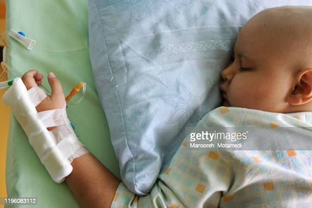 chemo with cancer in child patient concept - infused stock pictures, royalty-free photos & images