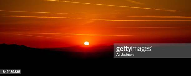 Chemtrail streaks at sunset