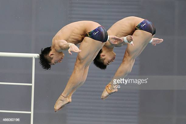 Chen Aisen and Lin Yue of China compete in men's diving 10m platform during day one of FINA/NVC Diving World Series 2015 at National Aquatics Center...