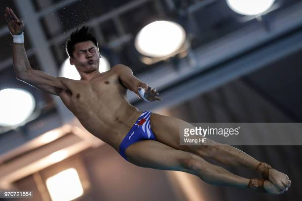 Chen Aisen of China competes in the men's 10m Springboard final on FINA Diving World Cup 2018 at the Wuhan Sports Center on June 10 2018 in Wuhan...